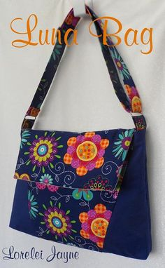 A PDF sewing pattern for a multi-size laptop bag. The Luna laptop bag with an adjustable strap holds a laptop. A flap closure secures your belongings as well as a zippered interior pocket. Messenger Bag Patterns, Bag Patterns To Sew, Pdf Sewing Patterns, Sewing Tutorials, Quilting Patterns, Messenger Bags, Sacs Design, Fabric Bags, Fabric Handbags