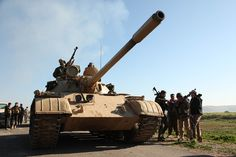 Kurdish Peshmerga fighters take control of an area on the outskirts of Mosul in northern...