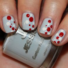This is technically a holiday dot manicure from Vampy Varnish, but to me it's a 99 Luftballoon manicure of awesome. Pale Blue base with white and red multi-sized dots.