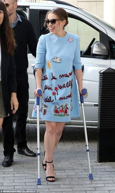 Stylish appearance: Emilia Clarke looked lovely as she stepped out in London on Thursday, wearing an eye-catching blue dress and a huge smile, despite being on crutches