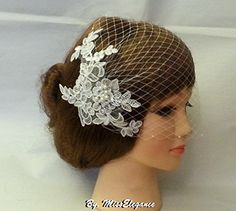 Birdcage veil.Birdcage veil with lace fascinator. Pearls & Diamonte Blusher veil,9 inch French/Russian Net Bridal Veil.l side comb bandeau style birdcage Veil,Hair accessory, (Ivory) (Ivory) MissElegance http://www.amazon.co.uk/dp/B014107Y76/ref=cm_sw_r_pi_dp_pAG7vb1F02QGR