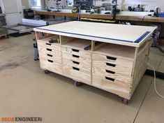 Inspiration from the Paulk workbench, the DIY workbench by Jen Woodhouse. Outfeed table for my table saw as well as a clamping/assembly workstation. Paulk Workbench, Workbench Plans Diy, Portable Workbench, Building A Workbench, Workbench Designs, Workbench Top, Mobile Workbench, Woodworking Workbench, Woodworking Shop