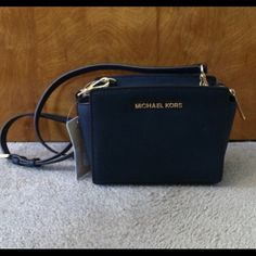 Michael Kors Navy Selma Crossbody This bag is brand new, never used. Make me a offer or might be open to trades! Michael Kors Bags Crossbody Bags