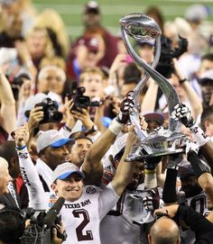 Aggie quarterback Johnny Manziel (2) and his teammates hoist the Cotton Bowl trophy after beating Oklahoma #aggies #cottonbowl