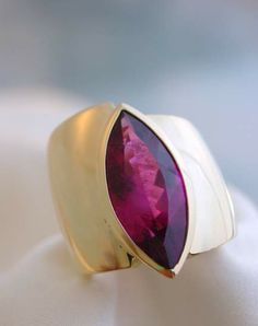 Large red marquise tourmaline in gold by Robert Schock