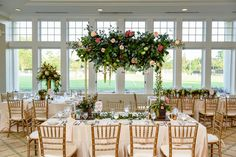 Floral chandelier, Elevated Tablescape, Garden Wedding, Philadelphia Wedding, Coral and Blush wedding  Florals and Event Design: http://www.lapetiteevents.com  Photography : Unique Concepts Studio Read More on SMP: http://www.stylemepretty.com/pennsylvania-weddings/philadelphia/2016/12/02/summer-cricket-club-wedding/