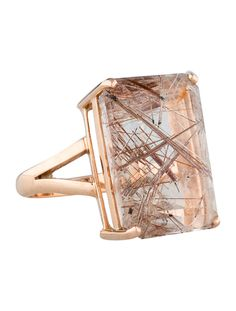 18K rose gold ring with prong-set rutilated kunzite. Ring size 7.   <b> This item has been inspected and appraised by our certified gemologist. </b>  <b>Metal:</b> 18K Rose Gold <b>Finish:</b> Bright <b>Total Gram Weight:</b> 9.2  <b>Stones:</b> Kunzite  <b>Cut:</b> Emerald <b>Color:</b> Light purplish pink <b>Total Carat Weight:</b> 22.84   Ring Size: 7