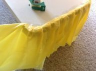 How to make a fancy ruffle table cloth from cheap dollar store plastic table cloths