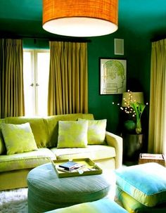 The blue-green in the room and the dash of redish-orange in the chandelier make this room split complementary.