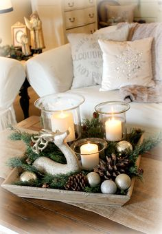 Fill a tray with candles, deer, evergreen, pine cones and Christmas ornaments.