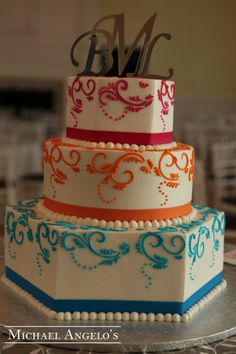 wedding sheet cake masculine | Rainbow Colored Wedding Cake Is Topped With Male And Female… News ...
