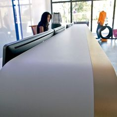 Modern interiors for offices using white & gold Formica laminates for a reception desk http://buzz.mw/b15z5_n #officedesign #furnituredesign