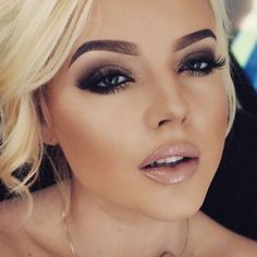 Love her brows and the smokey eyes with the nude lipstick.