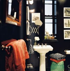 Love a single, small, classic wallmount mirror for guest bathroom. magical.