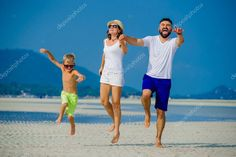 Happy young family of three having fun on the desert sunny beach Stock Photo , #Sponsored, #family, #fun, #Happy, #young #AD