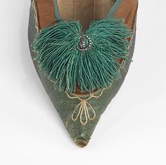 Cotton and Leather Slippers, 1805–10, European (close-up view). This pair of shoes is extraordinary in its unusual and charming ornament of a tiny silver owl with ruby eyes seated in a pearl-studded crescent moon.