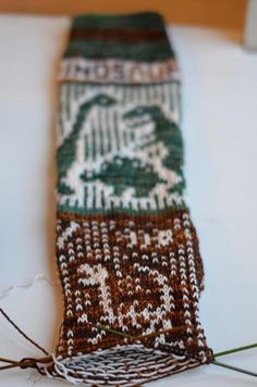 Dinosaurs, then and now -- on sock in progress by OsloAnn on flickr.