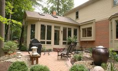 Three-season sunroom and patio by Neal's Design Remodel.
