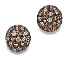 JAR Paris. A PAIR OF ZIRCON, ORANGE SAPPHIRE AND COLORED DIAMOND EAR CLIPS, BY JAR. Each designed as a circular bombé disk set with a series of foil-backed circular-cut zircons, surrounded by pavé-set orange sapphires and brown and yellow diamonds, mounted in 18k gold, with French assay mark and maker's mark. Signed JAR, Paris. Price Realized $85,000 / Estimate $30,000 - $50,000 [C. MAGNIFICENT JEWELS - 16 October 2007 - New York, Rockefeller Plaza] #JAR #JARParis #JoelArthurRosenthal