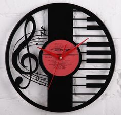 "Vinyl wall clock is hand made by us using an old 12"" vinyl record and a battery operated quartz clock movement. The wall clocks are fitted with a quality quartz movement with glossy red hands including an second hand."