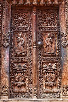 Carved Wooden Door at Bhaktapur in Nepal Print by © Robert Preston, via fineartamerica.com