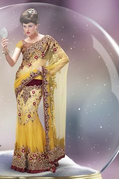 Description: Buy yellow net lehenga saree with best price at Variation. Huge collection of designer sarees online shopping, wedding sarees, party wear sarees & bridal saree designs with blouse. #designersarees #sareesonline #sarees #sari