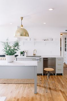 light gray & white kitchen with brushed brass fixtures