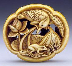 Ishikawa Rensai (Japan, born circa 1832) Lotus, Frog, and Bird, mid- to late 19th century Netsuke, Ivory with staining, inlays; ryusa type