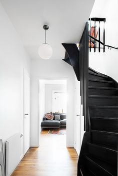 black staircase and white walls with globe pendant light fixture. Black Staircase, Open Staircase, Staircase Ideas, Black Banister, Staircase Walls, Entryway Stairs, Winding Staircase, Banisters, Interior And Exterior