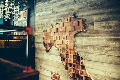 A map of Italy created from wooden lettered blocks for a restaurant project in Bristol Italy Map, Artwork Display, Installation Art, Clutter, Bristol, Lettering, Elegant, Create, Projects