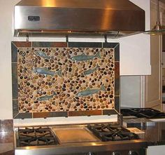 polished mixed river rock tile pebble tile backsplash with fishes