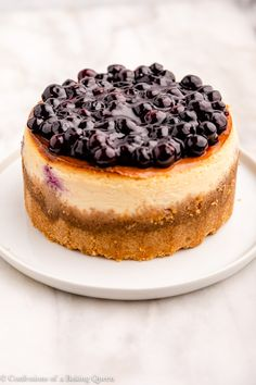 This recipe for Lemon Blueberry Cheesecake is tangy and creamy. This easy cheesecake recipe starts with a graham cracker crust filled with a thick and creamy cheesecake batter full of lemon zest and blueberries, baked to perfection then topped with a homemade blueberry sauce and fresh whipped cream. Everyone will swoon for this decadent dessert! Step-by-step photos help you make this dessert recipe! #cheesecakerecipe #makeaheaddessert #lemonblueberrydessert #lemon #blueberry #cheesecake Lemon Blueberry Cheesecake, Lemon Cheesecake Bars, Easy Cheesecake Recipes, Blueberry Sauce, Make Ahead Desserts, Spring Desserts, Bulgarian Recipes, Homemade Whipped Cream, Sweet Sauce