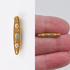 I present today a precious little gold and enamel bar pin brooch! This sweet pin is constructed of rich 14K yellow gold and it has a highly