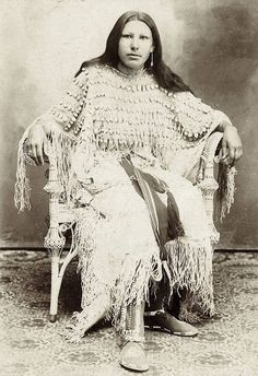 MOSES ON THE MESA White Fawn in an elk-tooth dress. Kiowa. ca. 1898. Photo by Irwin. Chikasha, Indian Territory (Oklahoma).