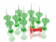 "Another photo of a ""pin"" being individual. this shows that they are all green except for one red, who stands out."