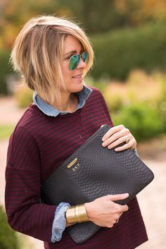 """clutch (GiGi New York c/o), shirt (Loftlove theDress Version), denim (Paige Denim c/o), sneaks (Converse ON SALE), cuff (Old, LOVE THIS BEVELED VERSION), shades (Ray Ban), watch (Daniel Wellington c/o 15% off using Code """"seersuckerandsaddles""""), chambray (J.Crew Factory ON SALE) All I can see in these shots is the white piece of lint on my …"""