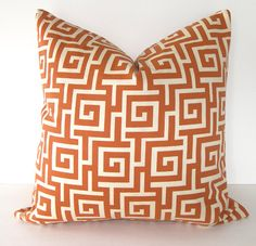 Loving Orange Accents Throw pillow inspiration for Shawn room