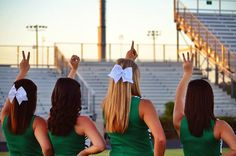 Cute picture for cheer/football season holding up the year, or class number with the grade level, example sophomores from my team holding up 2013, for the upcoming year!