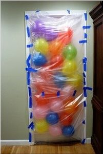 Balloons taped to the front of a birthday person's door; they'll all come tumbling down when they open the door!