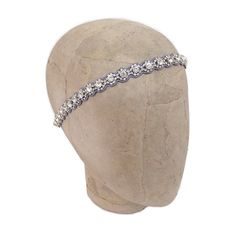 New Deepa Gurnani Katie Headband This Katie Crystal Headband will make any outfit feel more festive. Handcrafted in India, the crystal detailing and elegant scallop design will be your statement piece all season. Deepa Gurnani Accessories Hair Accessories