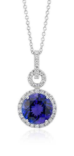 The brilliance of color is captured in this stunning pendant featuring a round faceted tanzanite gemstone framed by sparkling round diamonds.