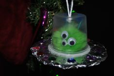 Thanks to Nancy for suggesting making alien spaceships with all of my left over Jello cups. I think these came out pretty cute and it's a g. Diy And Crafts, Arts And Crafts, Alien Spaceship, Crafty Kids, Pretty And Cute, Teaching Art, Christmas Ornaments, Christmas Ideas, Holiday Decor