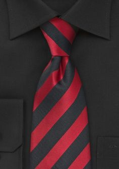 """Elevate your look this season with this visionary striped tie in bold shades of red and black. This remarkably well designed tie is the full package of style and quality. Designed by the Puccini Fashion Group and made from a stain resistant micro-fiber.     Take your outfit to the next level by pairing this tie with a solid black dress shirt, a black 3 button blazer and straight legged jeans in a dark wash.  For added color, pair this tie with a red handkerchief.     Length: 58"""", Width: 3.5"""""""