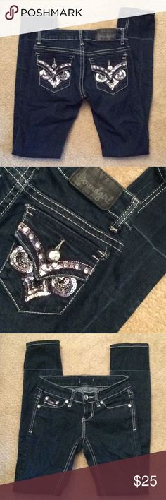 Soundgirl dark blue denim jeans sz 0 rhinestone I originally hemmed the jeans so they'd fit my daughter. We did not cut the hem so we were able to let them out later. Yes it did leave a wash line, but that was never seen under her boots. Size 0 Soundgirl Jeans Skinny