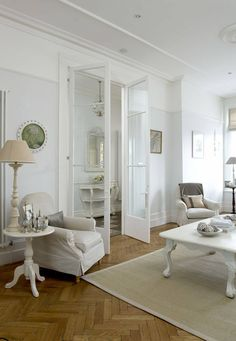 Simply gorgeous. Love it all, but especially the french doors, chandelier & mirror in the hall, & those amazing herringbone floors!