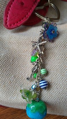 Items similar to Beaded Purse Charm / Keychain / Wallet Charm / Kindle Charm - Ocean Themed with Glass, Swarovski Crystals, and Acrylic Beads on Etsy Beaded Jewelry Designs, Diy Jewelry, Jewelry Making, Beaded Purses, Beaded Bracelets, Earrings Handmade, Handmade Jewelry, Key Chains, Acrylic Beads