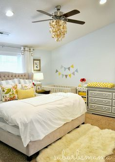 Cute idea when crib it in the parents room. Banner decal above the bed makes it look like crib is a part of the room. Love the gray and yellow combo.