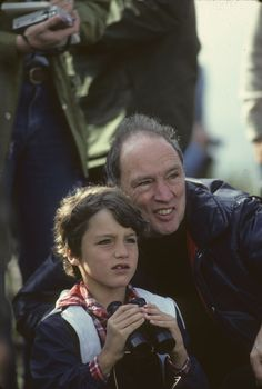 These two people are the young Justin Trudeau & his father Pierre Elliot Trudeau. It seems like Pierre is showing his son something, thus Justin Trudeau is staring. This picture illustrates that Justin Trudeau gets a good education from his father & he is a serious man.
