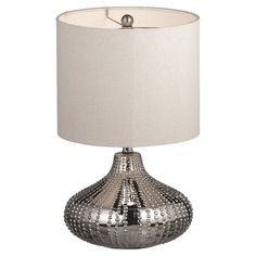 Ceramic table lamp with a textured chrome finish.    Product: Table lampConstruction Material: Ceramic, metal and fa...