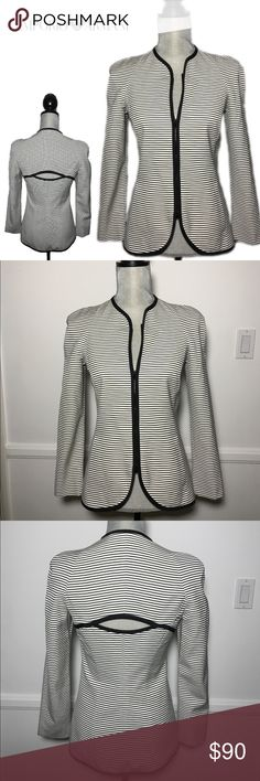 EMPORIO ARMANI Black and White Striped Blazer 38 EMPORIO ARMANI Black and White Striped Blazer. Gorgeous in Excellent used condition. Front pockets. Double zipper. Back Cutout detail. Made it Italy. Size 38 or XS / S in US Emporio Armani Jackets & Coats Blazers